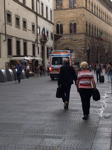 One of many ambulances screeching its way down Florence's narrow streets. Pedestrians tend to get out of the way fairly quickly.
